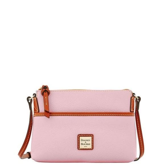 Dooney & Bourke Handbags - DOONEY and BOURKE pebble baby pink leather purse